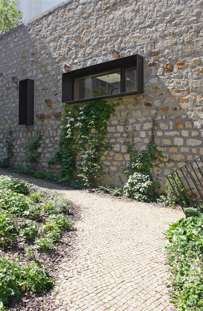 percement de baie dans le mur mitoyen du foyer Mélingue